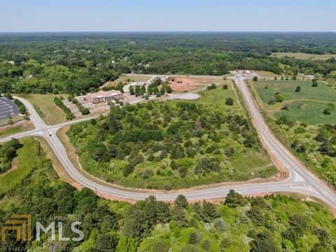 Located in Monroe. Zoned B3 Commercial. At future entrance to YMCA site. On Double Springs Connector Road heading towards Monroe Area High School and WBOE.