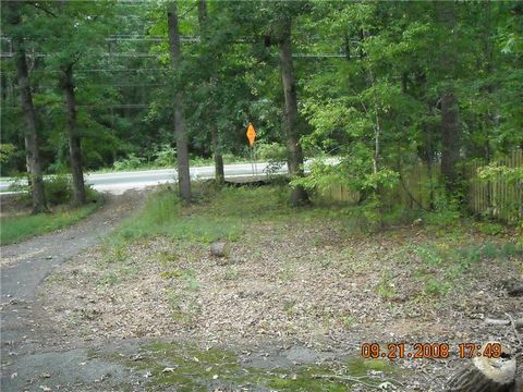 Located in Marietta. HUGE PRICE ADJUSTMENT!! NEW SURVEY, PARCEL is .99 ACRES!! Zoned R-20. Possibly build 2 homes or Room for a larger home with circular drive ?? Mature beautiful trees, Flat lot, Great School District. Convenient to shopping, Dining...