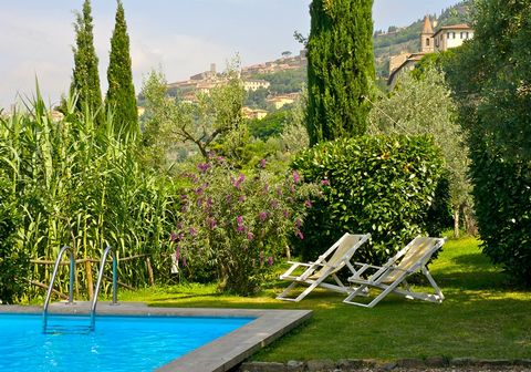 Situated in the middle of a hill, under the watchful eye of the beautiful town of Cortona, you will find the ancient, noble villa, surrounded by olive groves and an old rustic park. Here you can relax and enjoy the stately cypress trees, the pine tre...
