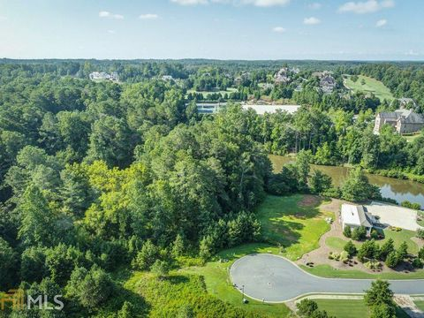Located in Alpharetta. Stunning homesite on one of the last remaining lots in the Manor Golf and Country Club! Build your dream home on this 2+ acre lot that will have water views. Fabulous community amenities include luxury club house/restaurant, in...