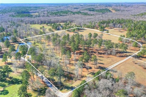 Located in Monroe. Last Remaining Tract in This Luxury Gated Community of Estate Size Lots! 23.3 Acres of Partially Wooded Level Topography Boasts A Pond and Many Beautiful Building Sites to Choose From * 145 Feet Deep Well Already in Place Along wit...