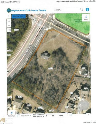 Located in Marietta. One-Of-A-Kind opportunity to develop a property on a large 3.69 acres in the upscale community of West Cobb minutes to Kennesaw Mountain, Marietta Square, Marietta Country Club, Mt Paran School. Ideally situated between Dallas HW...