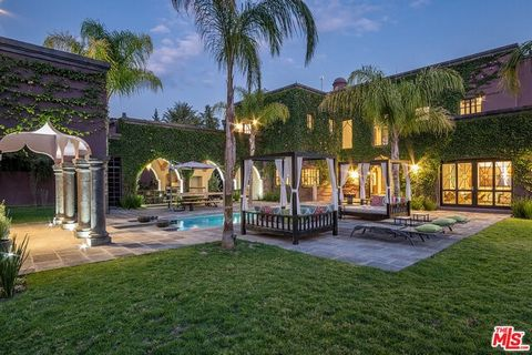 Lush gardens, fountains, and grand staircase lead you to a double height foyer, custom stone fireplaces, retractable roof and custom banquet seating. Main house features black canterra floors, custom bar and chefs kitchen. There are 2 large master su...