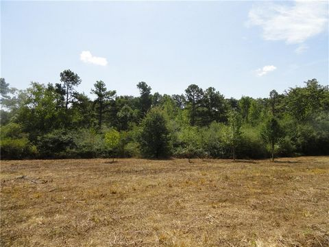 Located in Gainesville. Build your dream home. Perfect for equestrian estate. Beautiful 16.12 +/- acre building lot with hardwoods and open pasture in the front. Great location with no HOA or subdivision requirements. Utilities available. Zoned A1. I...