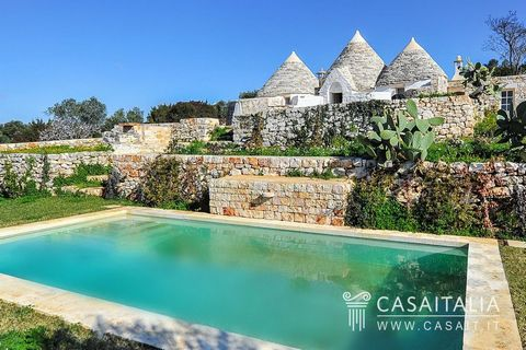 Brief description Trullo with pool in panoramic location between Ostuni and Martina Franca. Carefully restored with living room, kitchen, sitting room with fireplace, two bedrooms and two bathrooms. Garden and 3900 sq.m of private land. Geographic po...