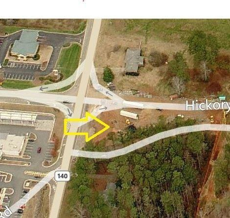Located in Canton. +/- 0.67 acre corner parcel in Hickory Flat at the corner of 140 and Hickory Rd. The property sits at an intersection with Kroger anchored retail across the street.