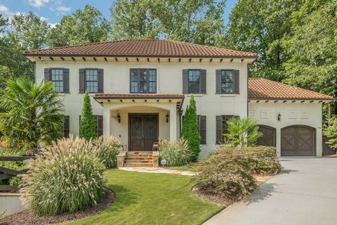 Beautiful home in Castlewood neighborhood in Buckhead. Your private oasis in the heart of the city with level back yard and heated pool and spa, fully fenced with gated entrance. Designer finishes including 10 foot ceiling, stone fireplace in the fam...